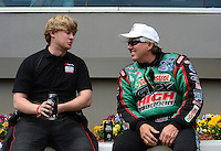 Apr. 15, 2012; Concord, NC, USA: NHRA funny car driver Blake Alexander (left) talks with John Force during the Four Wide Nationals at zMax Dragway. Mandatory Credit: Mark J. Rebilas-