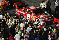 Feb 9, 2008; Daytona, FL, USA; Fans surround the car of Nascar Sprint Cup Series driver Kasey Kahne (9) prior to the Bud Shootout at Daytona International Speedway. Mandatory Credit: Mark J. Rebilas-US PRESSWIRE