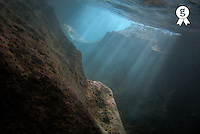 Sunrays penetrating underwater cave near surface, underwater view (Licence this image exclusively with Getty: http://www.gettyimages.com/detail/73013994 )