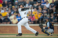 Johnny Aiello (2) of the Wake Forest Demon Deacons follows through on his swing against the West Virginia Mountaineers in Game Four of the Winston-Salem Regional in the 2017 College World Series at David F. Couch Ballpark on June 3, 2017 in Winston-Salem, North Carolina.  The Demon Deacons walked-off the Mountaineers 4-3.  (Brian Westerholt/Four Seam Images)