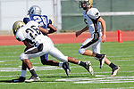 Torrance, CA 09/08/11 - unidentified North player, James Nelson (Peninsula #26) and Max MacLeay (Peninsula #5) in action during the North-Peninsula Junior Varsity Football game at North High School in Torrance.