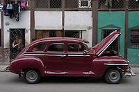 wine red Plymouth oldtimer, american car in Havana, Cuba