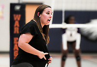 NWA Democrat-Gazette/CHARLIE KAIJO Rogers Heritage High School head coach Lindsey Biocic gives directions during a volleyball game, Thursday, October 11, 2018 at Rogers Heritage High School in Rogers.