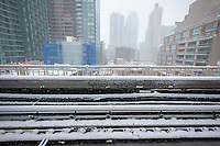 A view of snow covered Long Island City from the  Queensboro Plaza station in New York during the city's first major winter storm of the season on Thursday, February 9, 2017. Meteorologists are forecasting between 8 and 14 inches of snow in the New York City region. The Metropolitan Transportation Authority has had no major delays and the trains continue to run.  (© Richard B. Levine)