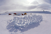 A well-worn wind wall made of snow blocks is part of the landscape during survival training for participants in the US Antarctic Program near McMurdo Station, Antarctica. Ernie Mastroianni photo
