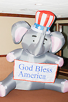 "An inflatable elephant holding a sign reading ""God Bless America"" sits in a hallway near the Palm Beach Republican Club and West Palm Beach Victory Headquarters office in West Palm Beach, Florida. The office serves as a place for volunteers to gather and organize for various Republican campaigns, including Donald Trump's general election campaign."