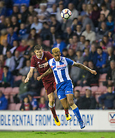 James Milner of Liverpool & Kaiyne Woolery of Wigan Athletic during the pre season friendly match between Wigan Athletic and Liverpool at the DW Stadium, Wigan, England on 14 July 2017. Photo by Andy Rowland.