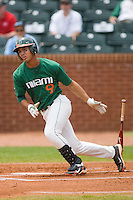 Harold Martinez #9 of the Miami Hurricanes follows through on his swing against the Boston College Eagles at the 2010 ACC Baseball Tournament at NewBridge Bank Park May 27, 2010, in Greensboro, North Carolina.  The Eagles defeated the Hurricanes 12-10 in 10 innings.  Photo by Brian Westerholt / Four Seam Images