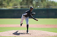 Chicago White Sox relief pitcher Yordi Rosario (59) delivers a pitch during an Instructional League game against the Kansas City Royals at Camelback Ranch on September 25, 2018 in Glendale, Arizona. (Zachary Lucy/Four Seam Images)