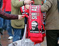 Pictured: Sir Alex Ferguson souvenir scarves sold by street vendors outside the ground before kick off. Sunday 12 May 2013<br /> Re: Barclay's Premier League, Manchester City FC v Swansea City FC at the Old Trafford Stadium, Manchester.