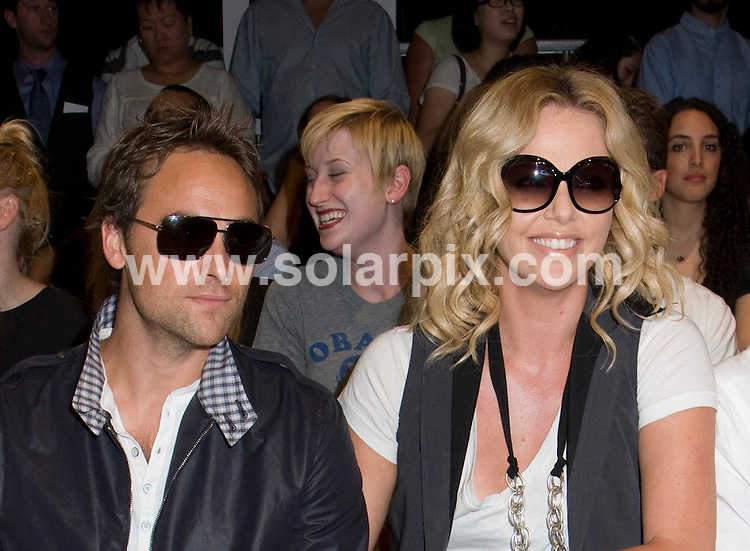**ALL ROUND PICTURES FROM SOLARPIX.COM**.**SYNDICATION RIGHTS FOR UK, SPAIN, PORTUGAL, AUSTRALIA, S.AFRICA & DUBAI (U.A.E) ONLY**.The Mercedes Benz Fashion Week Spring 2009 at the Rag & Bone in the Front Row of Pier 94 in New York in the USA. .This pic:Stuart Townsend and Charlize Theron..JOB REF:7232-PHZ/Janet Mayer    DATE:06_09_08 .**MUST CREDIT SOLARPIX.COM OR DOUBLE FEE WILL BE CHARGED* *UNDER NO CIRCUMSTANCES IS THIS IMAGE TO BE REPRODUCED FOR ANY ONLINE EDITION WITHOUT PRIOR PERMISSION*