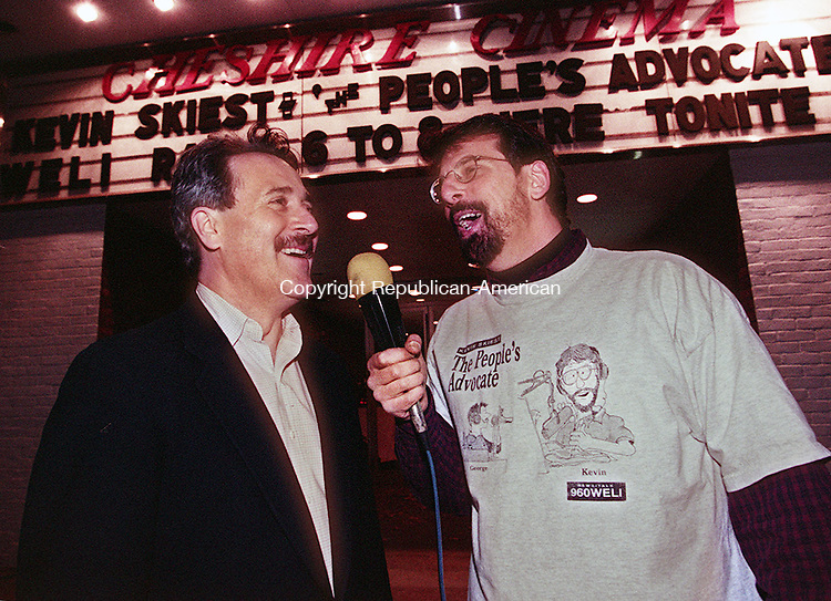 CHESHIRE,CT-11/12/98-1112CK04.tif-WELI radio host Kevin Skiest speaks to Cheshire Cinema owner Peter Spodick infront of the cinema during a radio interview on Thursday in Cheshire.    CASEY KEIL PHOTO.
