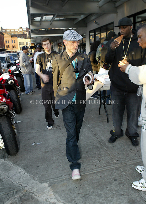 WWW.ACEPIXS.COM . . . . .***EXCLUSIVE!!! FEE MUST BE NEGOTIATED BEFORE USE!!!***....NEW YORK, APRIL 21, 2005....Michael Stipe barely looks up at our photographer while walking in the West Village.....Please byline: Ian Wingfield - ACE PICTURES..... *** ***..Ace Pictures, Inc:  ..Craig Ashby (212) 243-8787..e-mail: picturedesk@acepixs.com..web: http://www.acepixs.com