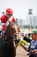 Fort Larned with jockey Julien Leparoux after winning the 1 3/16 Skip Away Stakes (G3). Gulfstream Park Hallandale Beach Florida. 03-31-2012. Arron Haggart / Eclipse Sportswire