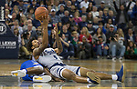 Nevada guard Nisre Zouzoua (5) passes the ball from the seat of his pants against South Dakota State in the second half of an NCAA college basketball game in Reno, Nev., Saturday, Dec. 15, 2018. (AP Photo/Tom R. Smedes)