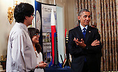 United States President Barack Obama meets with a team from the US Virgin Islands that design rockets for the Team America Rocketry Challenge, during the 2015 White House Science Fair, a celebration of students winners of STEM (Science, technology, engineering and math) competitions from across the country at the White House, in Washington, DC on March 23, 2015. <br /> Credit: Aude Guerrucci / Pool via CNP