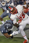New Mexico running back Ahmari Davis (28) is tackled Nevada defensive back Tyson Williams (6) in the first half of an NCAA college football game in Reno, Nev., Saturday, Nov. 2, 2019. (AP Photo/Tom R. Smedes)