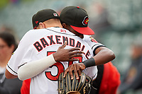 Rochester Red Wings Nick Gordon (1) hugs pitcher DJ Baxendale (55) before an International League game against the Buffalo Bisons on May 31, 2019 at Frontier Field in Rochester, New York.  Rochester defeated Buffalo 5-4 in ten innings.  (Mike Janes/Four Seam Images)