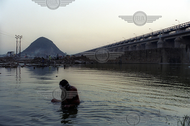 A devotee washing himself before going to pray at one of the most important places of pilgrimage for Hindus, the Tirumala Venkateshwara Temple, the 'Holy Hill'.