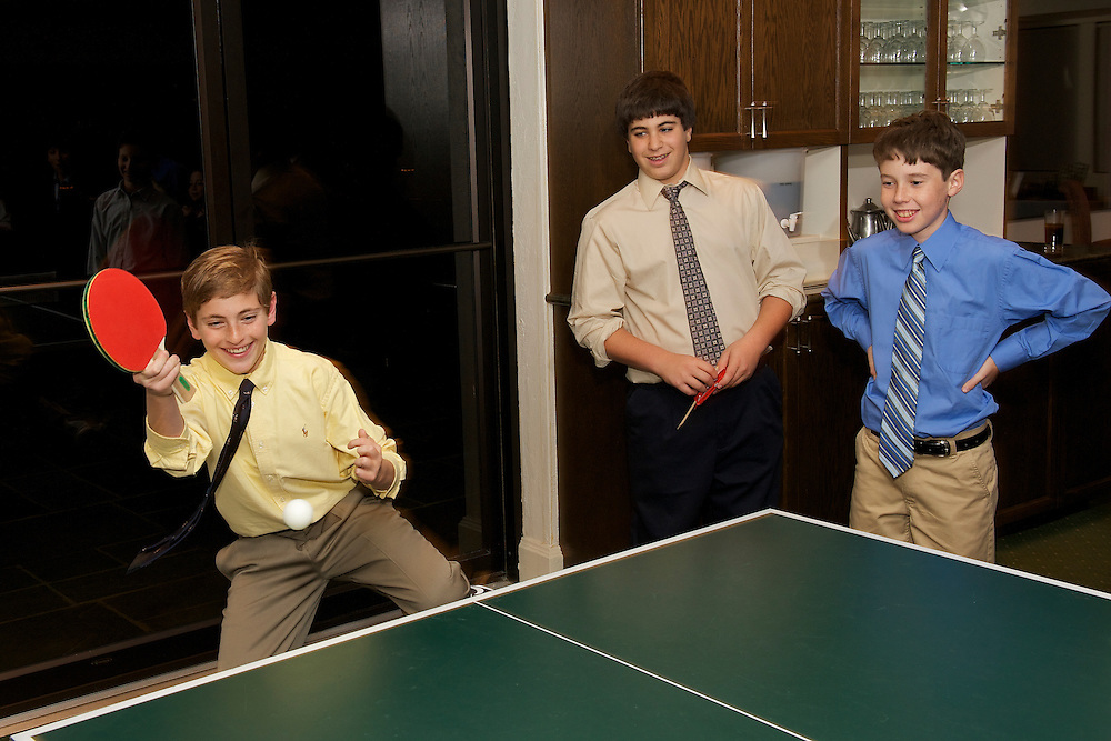 Bar Mitzvah boy playing ping pong