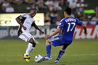 Sainey Nyassi (white), Roger Espinoza...Kansas City Wizards defeated New England Revolution 4-1 at Community America Ballpark, Kansas City , Kansas.