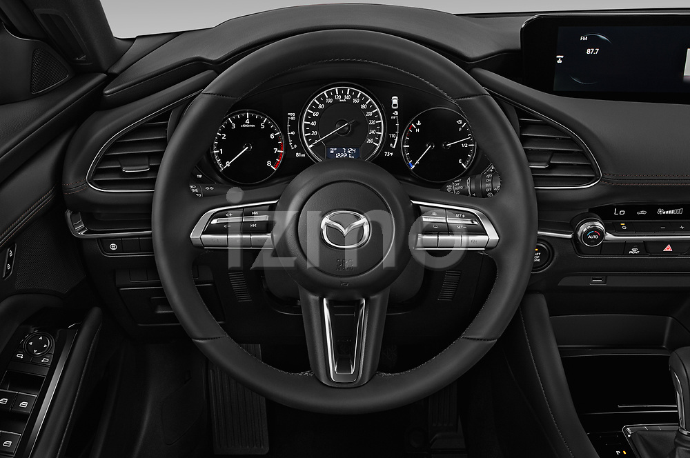 Car pictures of steering wheel view of a 2019 Mazda Mazda3 Skydrive 5 Door Hatchback Steering Wheel