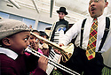 "story: Jazz.date: 4-8-02.caption: Delfeayo Marsalis gives a hand to 6 year old Emari Tabb of Detroit trying to play Marsalis' trombone after performing ""Jazz and Jazmine Meet the Jazz Band, an original work by Marsalis designed to introduce children ages 3-8 to Jazz by way of a puupet show. Emari Tabb said after trying Marsalis' trombone....""I play the drums too.""  The show took place at Focus:HOPE Conference Center on Oakman in Detroit on Monday April 8."