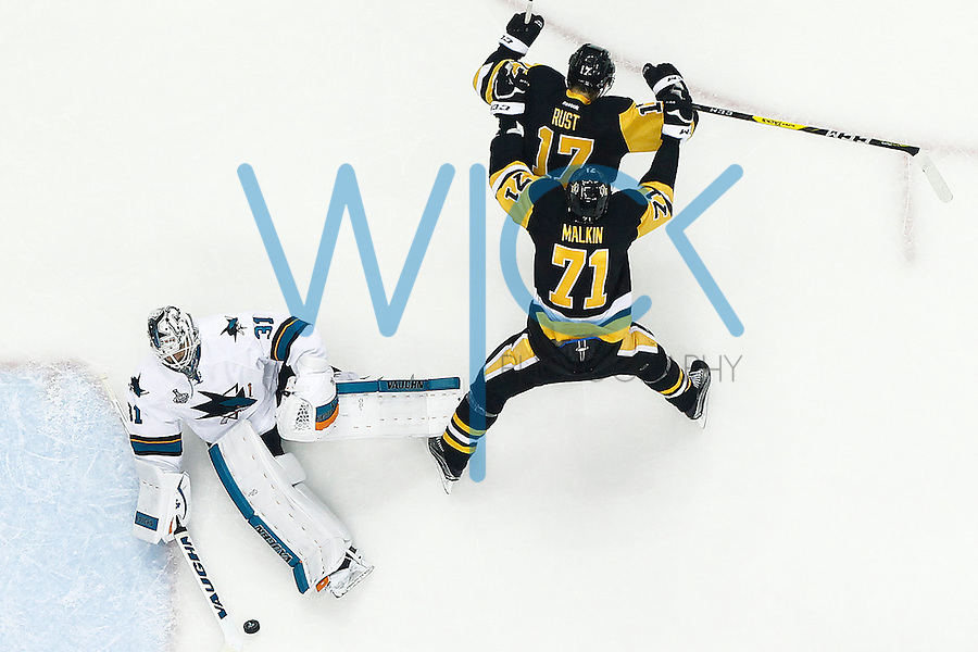 Bryan Rust #17 of the Pittsburgh Penguins celebrates his goal with teammate Evgeni Malkin #71 of the Pittsburgh Penguins past Martin Jones #31 of the San Jose Sharks in the first period during game one of the Stanley Cup Final at Consol Energy Center in Pittsburgh, Pennslyvania on May 30, 2016. (Photo by Jared Wickerham / DKPS)