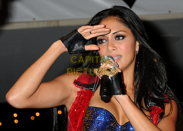 "THE PUSSYCAT DOLLS - NICOLE SCHERZINGER .The Pussycat Dolls Celebrate the release of their new album ""Doll Domination"" with a free concert at Hollywood & Highland, Hollywood, California, USA..September 23rd, 2008.half length singing stage concert live gig performance red blue bra beads beaded cleavage glove .CAP/ADM/BP.©Byron Purvis/AdMedia/Capital Pictures."