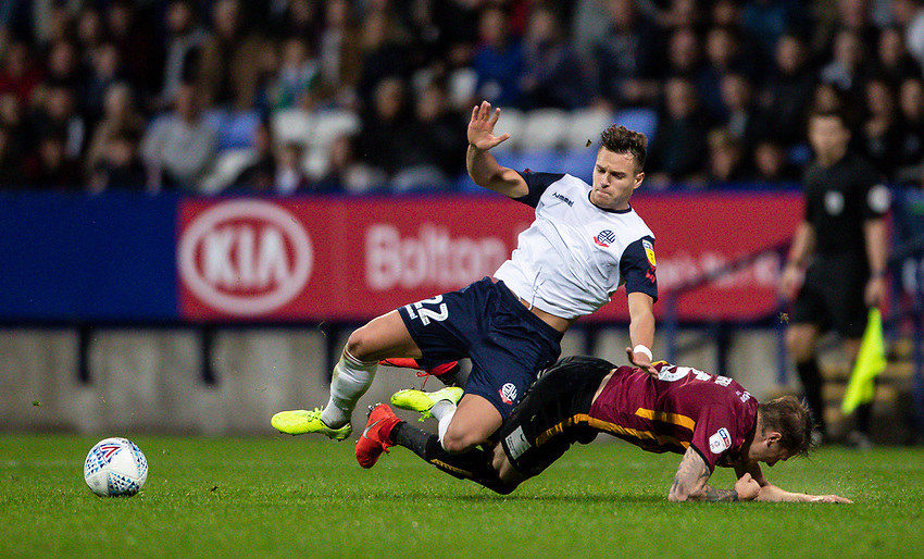 Bolton Wanderers' Dennis Politic competing with Bradford City's Tyler French (right) <br /> <br /> Photographer Andrew Kearns/CameraSport<br /> <br /> EFL Leasing.com Trophy - Northern Section - Group F - Bolton Wanderers v Bradford City -  Tuesday 3rd September 2019 - University of Bolton Stadium - Bolton<br />  <br /> World Copyright © 2018 CameraSport. All rights reserved. 43 Linden Ave. Countesthorpe. Leicester. England. LE8 5PG - Tel: +44 (0) 116 277 4147 - admin@camerasport.com - www.camerasport.com