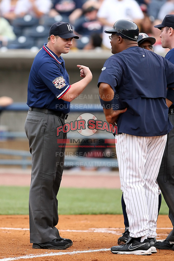 """June 12th 2008:  First base umpire Kevin Causey explains his call to Leon """"Bull"""" Durham of the Toledo Mudhens, Class-AAA affiliate of the Detroit Tigers, during a game at Fifth Third Field in Toledo, OH.  Causey ejected Mike Hessman after hitting a home run.  Photo by:  Mike Janes/Four Seam Images"""