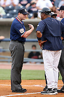 "June 12th 2008:  First base umpire Kevin Causey explains his call to Leon ""Bull"" Durham of the Toledo Mudhens, Class-AAA affiliate of the Detroit Tigers, during a game at Fifth Third Field in Toledo, OH.  Causey ejected Mike Hessman after hitting a home run.  Photo by:  Mike Janes/Four Seam Images"