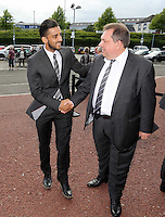 Pictured: Neil Taylor greets Kevin Johns as they both arrive Wednesday 20 May 2015<br /> Re: Swansea City FC Awards Dinner at the Liberty Stadium, south Wales, UK