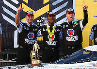 Aug 20, 2016; Brainerd, MN, USA; NHRA top fuel driver Antron Brown celebrates with crew chief Mark Oswald and Brian Corrade after winning the Protect the Harvest Nationals from Seattle, WA that was delayed by rain to run during qualifying for the Lucas Oil Nationals at Brainerd International Raceway. Mandatory Credit: Mark J. Rebilas-USA TODAY Sports