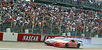 Ricky Craven and Kurt Bush bang together as they race for the win late in the Carolina Dodge Dealers 400 NASCAR WInston Cup race at Darlington Raceway, Darlington, SC, March 16, 2003.  (Photo by Brian Cleary/www.bcpix.com)