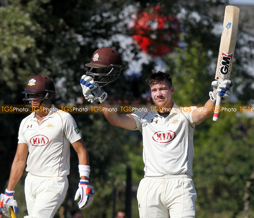 Rory Burns celebrates scoring a century of runs.