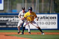 Michigan Wolverines left fielder Miles Lewis (3) leads off second base in front of shortstop Trey Martin (6) during a game against Army West Point on February 17, 2018 at Tradition Field in St. Lucie, Florida.  Army defeated Michigan 4-3.  (Mike Janes/Four Seam Images)