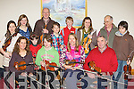 Swapping tunes at the Gathering festival fiddle workshop in the Gleneagle Hotel Saturday morning front row l-r: Juliet Rossebo Norway, Jess Nixon Canada, Emma O'Leary Scartaglen, Connie O'Connell Kilnamatra. Back row: Henriette Rossebo Norway, Meaghan O'Connor, Isli?nn Ni? Chroni?n Killarney, John Connolly Listowel, Christopher Rossebo Norway, Conor O'Neill Midleton, Laura McClintock Kilgarvan, Minicale Bijton Andreotti Corsica and Cieran Galligan Killarney