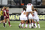 02 December 2011: Stanford teammates congratulate Chioma Ubogagu (occluded) after her goal. The Stanford University Cardinal defeated the Florida State University Seminoles 3-0 at KSU Soccer Stadium in Kennesaw, Georgia in an NCAA Division I Women's Soccer College Cup semifinal game.