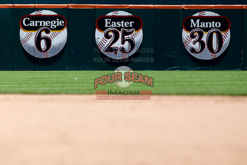 Buffalo Bisons retired numbers on the outfield fence honoring Ollie Carnegie, Luke Easter, and Jeff Manto during a game against the Toledo Mudhens at Coca-Cola Field on August 17, 2011 in Buffalo, New York.  Buffalo defeated Toledo 4-2.  (Mike Janes/Four Seam Images)