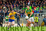 Kerry Aidan O'Mahony gets away his pass under pressure from Ciaran murtagh  Roscommon  during their NFKL Div 1 clash in Fitzgerald Stadium on Sunday