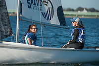 Salve's Jen Killian,'17, right, captain, and Madeline Lark,'19, crew, work together in the Newport Harbor as they practice with other members of the Salve Regina Sailing Team.