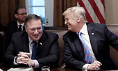 United States Secretary of State Mike Pompeo and US President Trump share a laugh during a cabinet meeting in the Cabinet Room of the White House, July 18, 2018 in Washington, DC. <br /> Credit: Olivier Douliery / Pool via CNP