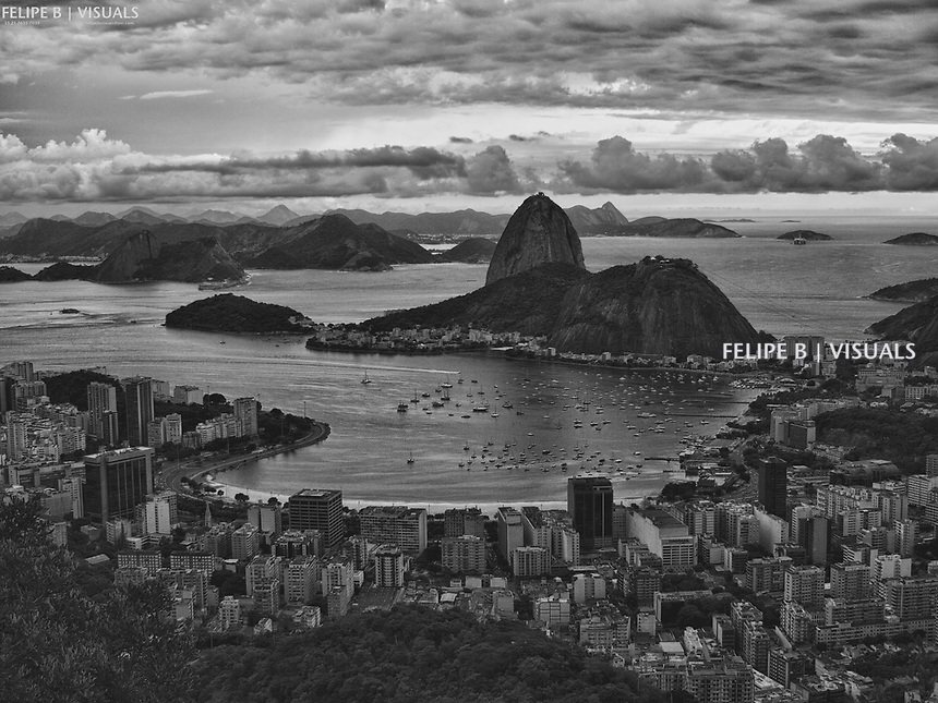 OLYMPUS DIGITAL CAMERA Rio under heavy sky.<br /> photo: Felipe B, January 2010<br /> Olympus E-420, Zuiko Digital 25mm.