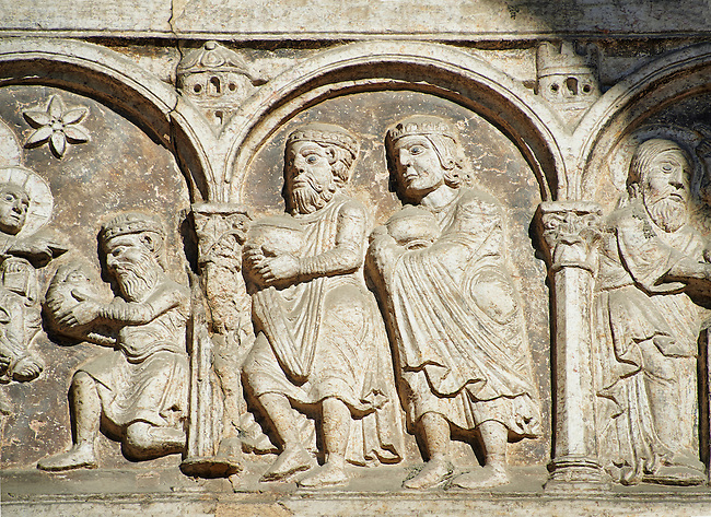 Scenes from the life of Christ - The Coming of the Three Kings - the work of the sculptor Nicholaus, on the main portal  of the 12th century Romanesque Ferrara Duomo, Italy