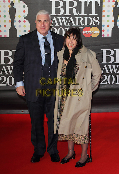 Mitch Winehouse and wife Janice.Arrivals for The 2013 Brit Awards at the O2 Arena, London, England..February 20th 2013.BRITS full length daughter Amy Amy's dad father checked plaid navy suit shirt waistcoat family mother mom mum walking stick cane parents leopard animal dress .CAP/ROS.©Steve Ross/Capital Pictures