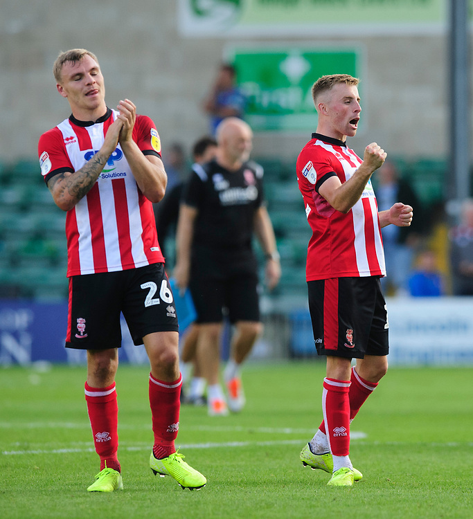 Lincoln City's Harry Anderson, left, and Lincoln City's Joe Morrell at the end of the game<br /> <br /> Photographer Chris Vaughan/CameraSport<br /> <br /> The EFL Sky Bet League One - Lincoln City v Fleetwood Town - Saturday 31st August 2019 - Sincil Bank - Lincoln<br /> <br /> World Copyright © 2019 CameraSport. All rights reserved. 43 Linden Ave. Countesthorpe. Leicester. England. LE8 5PG - Tel: +44 (0) 116 277 4147 - admin@camerasport.com - www.camerasport.com