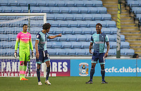 Sido Jombati & Anthony Stewart (5) of Wycombe Wanderers reactions following the second goal during the The Checkatrade Trophy - EFL Trophy Semi Final match between Coventry City and Wycombe Wanderers at the Ricoh Arena, Coventry, England on 7 February 2017. Photo by Andy Rowland.