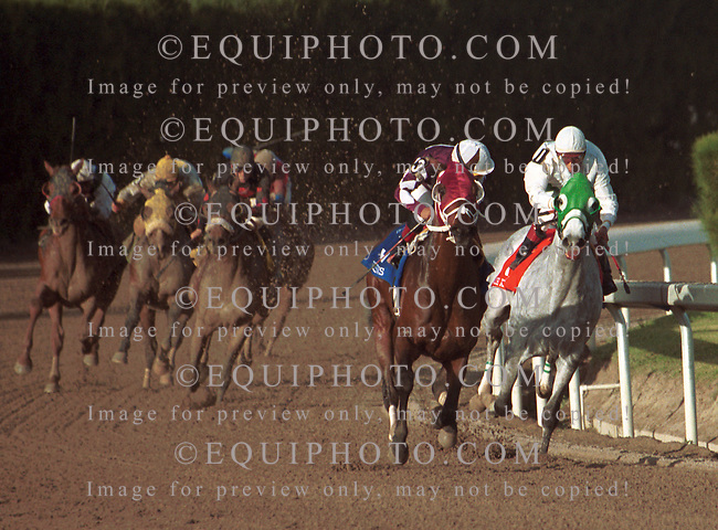 Jockey Jorge Chavez looks over his shoulder as Behrens pulls away from With Anticipation and Edgar Prado (right) to win the Gulfstream Park Handicap. Photo By EQUI-PHOTO. 2/26/00