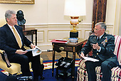 United States President Bill Clinton receives a briefing from the Chairman of the Joint Chiefs of Staff, US Army General John Shalikashvili, prior to departing for an overseas trip in the Oval Office of the White House in Washington, DC on Tuesday, November 28, 1995.<br /> Mandatory Credit: Ralph Alswang / White House via CNP